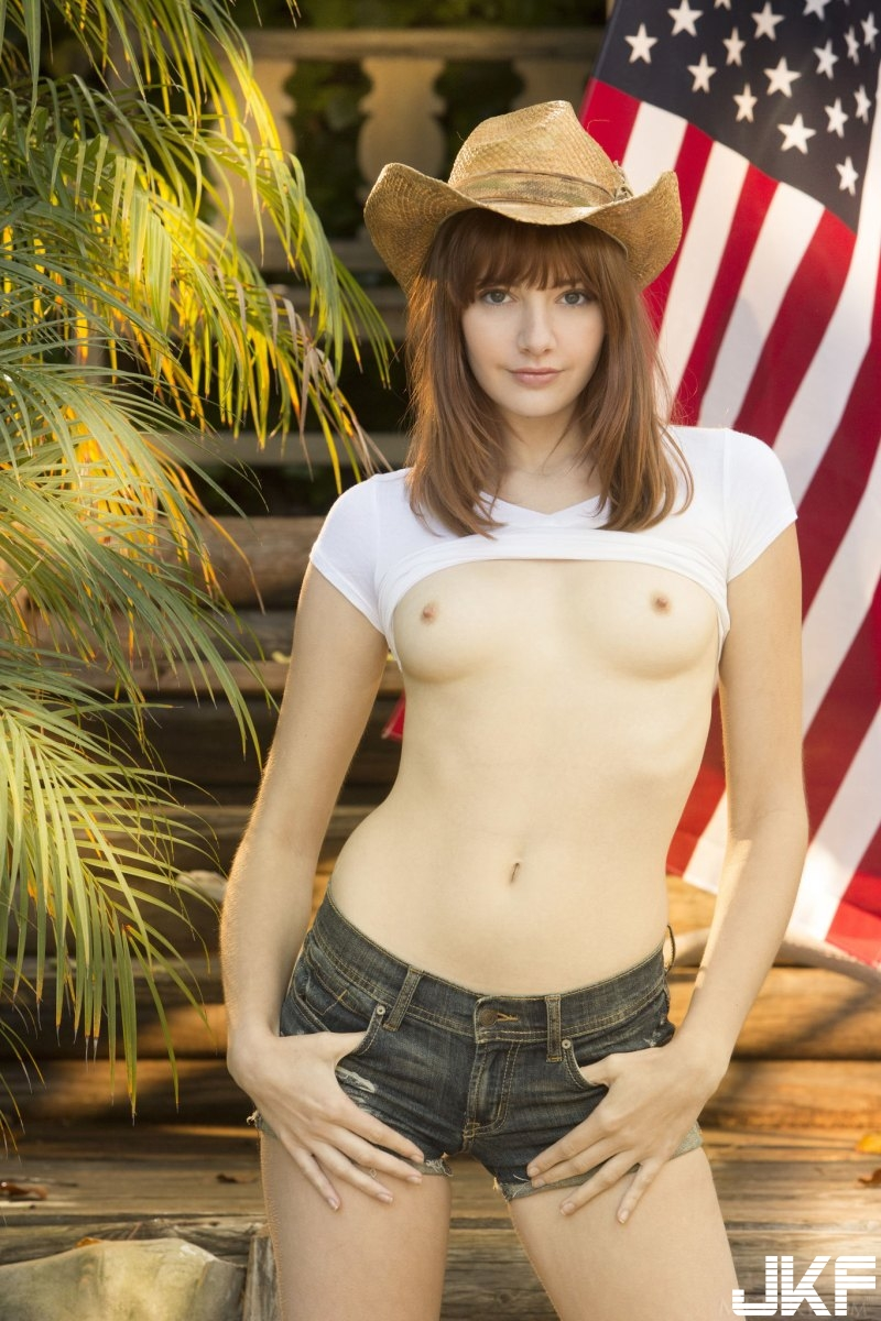 sexy-american-cowgirl-lena-anderson-teasing-outside-on-the-porch-04.jpg