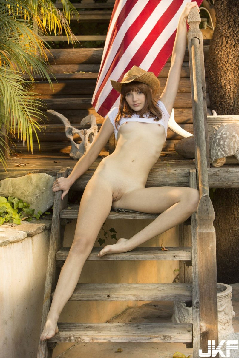 sexy-american-cowgirl-lena-anderson-teasing-outside-on-the-porch-12.jpg
