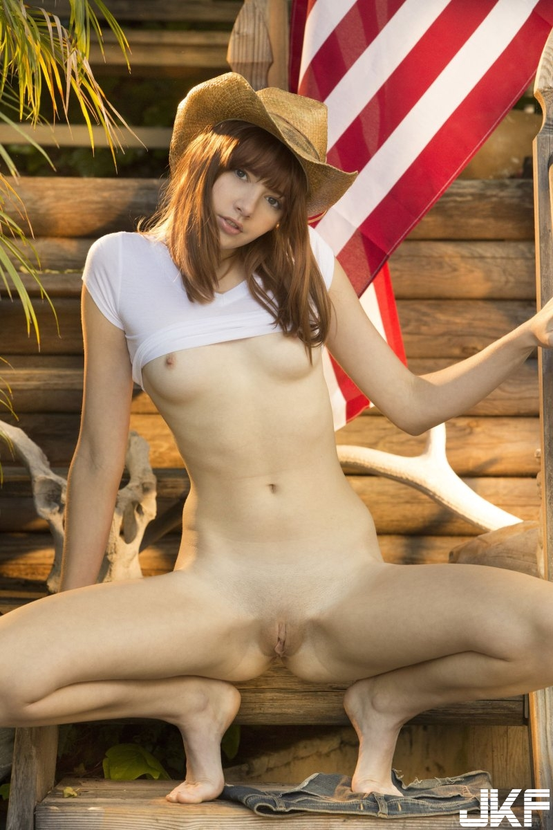 sexy-american-cowgirl-lena-anderson-teasing-outside-on-the-porch-15.jpg