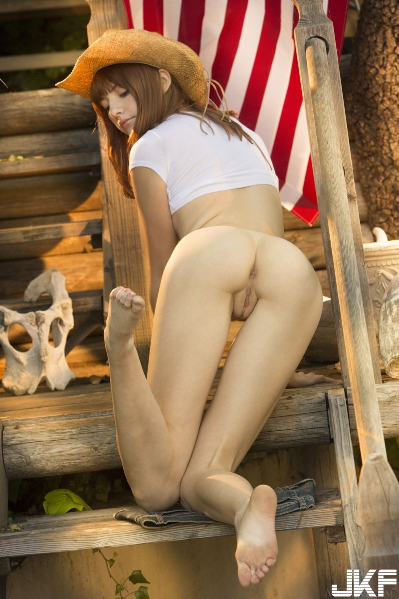 sexy-american-cowgirl-lena-anderson-teasing-outside-on-the-porch-14.jpg