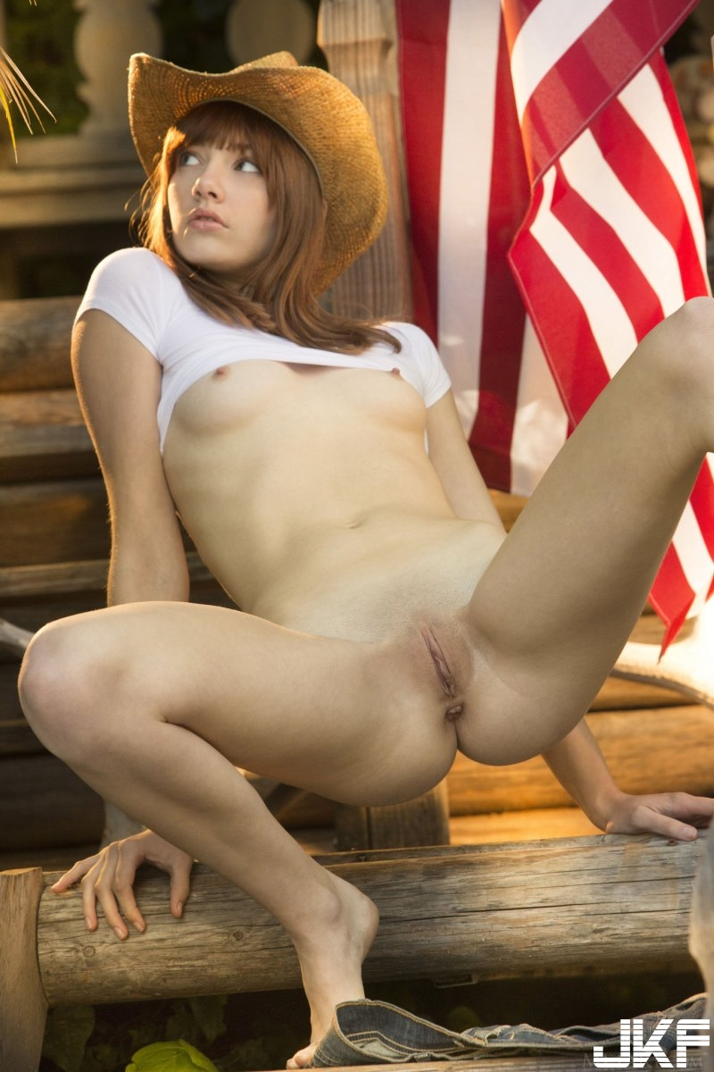 sexy-american-cowgirl-lena-anderson-teasing-outside-on-the-porch-17.jpg
