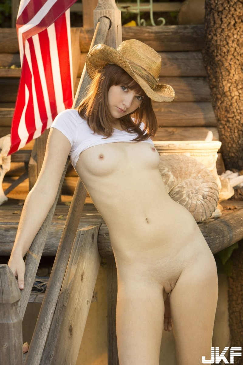 sexy-american-cowgirl-lena-anderson-teasing-outside-on-the-porch-19.jpg