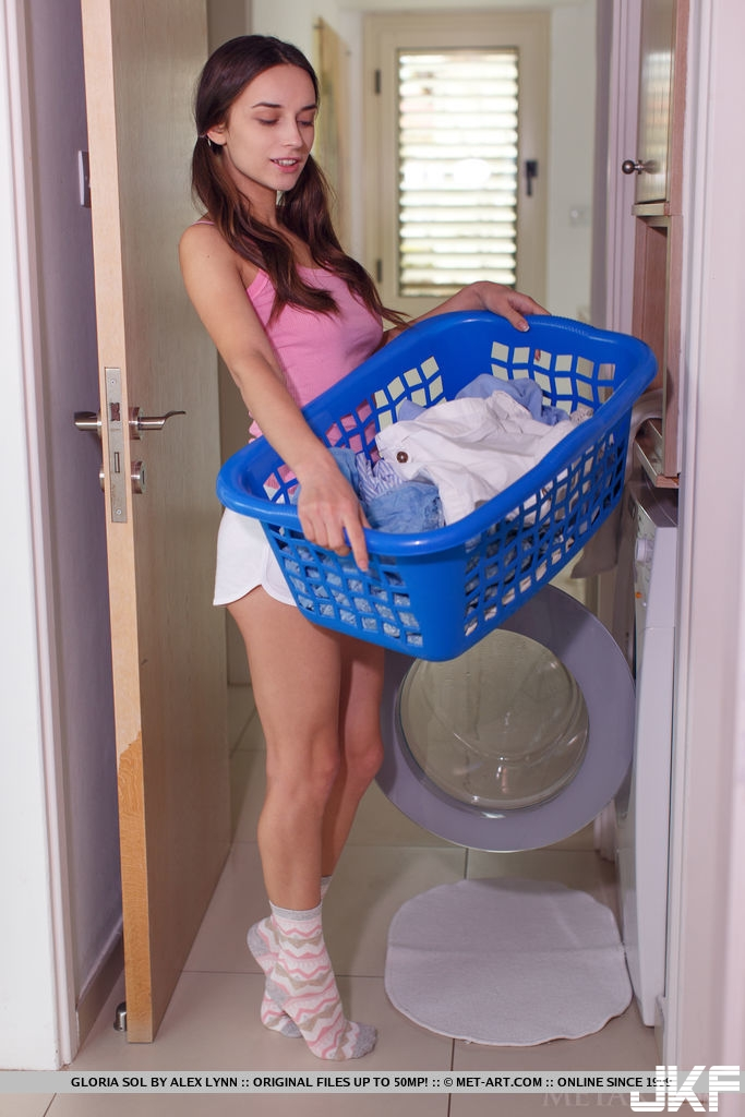 busty-gloria-sol-undresses-while-doing-the-laundry-01.jpg