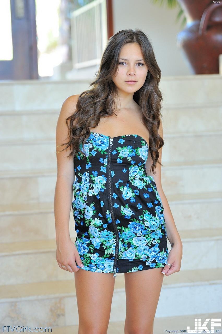 Shaved-Brunette-Babe-Nina-James-with-Brown-Eyes-from-FTV-Wearing-Blue-Dress-1.jpg