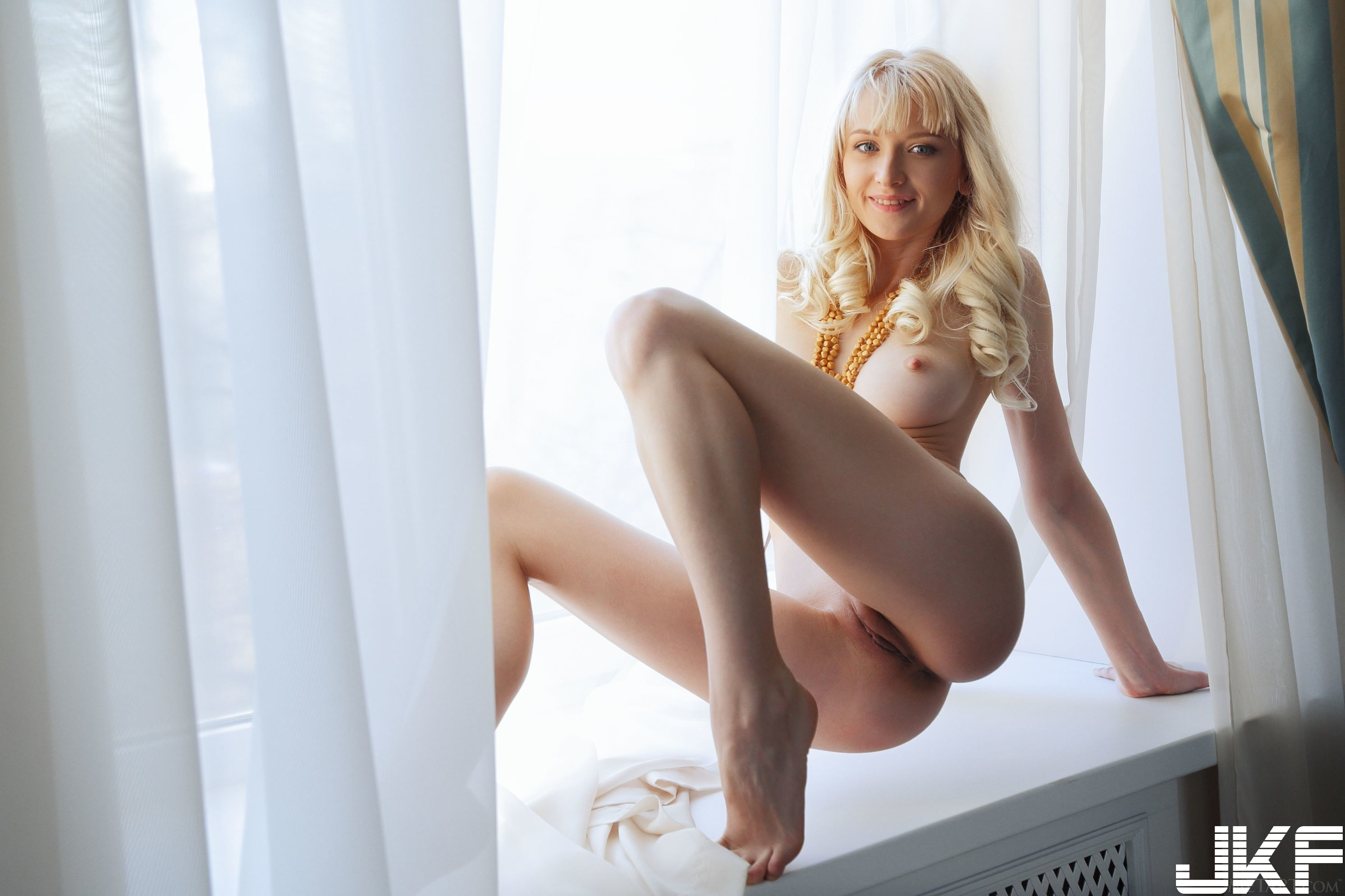 Shaved-Blonde-Adelia-B-with-Plump-Pussy-11.jpg