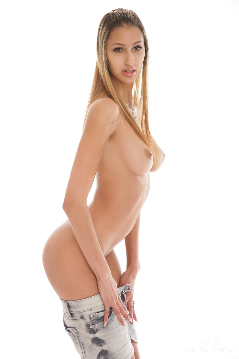 Teen-Shaved-Blonde-Babe-Kitty-Jane-with-Outie-Belly-Button-from-W4B-Wearing-Plat.jpg