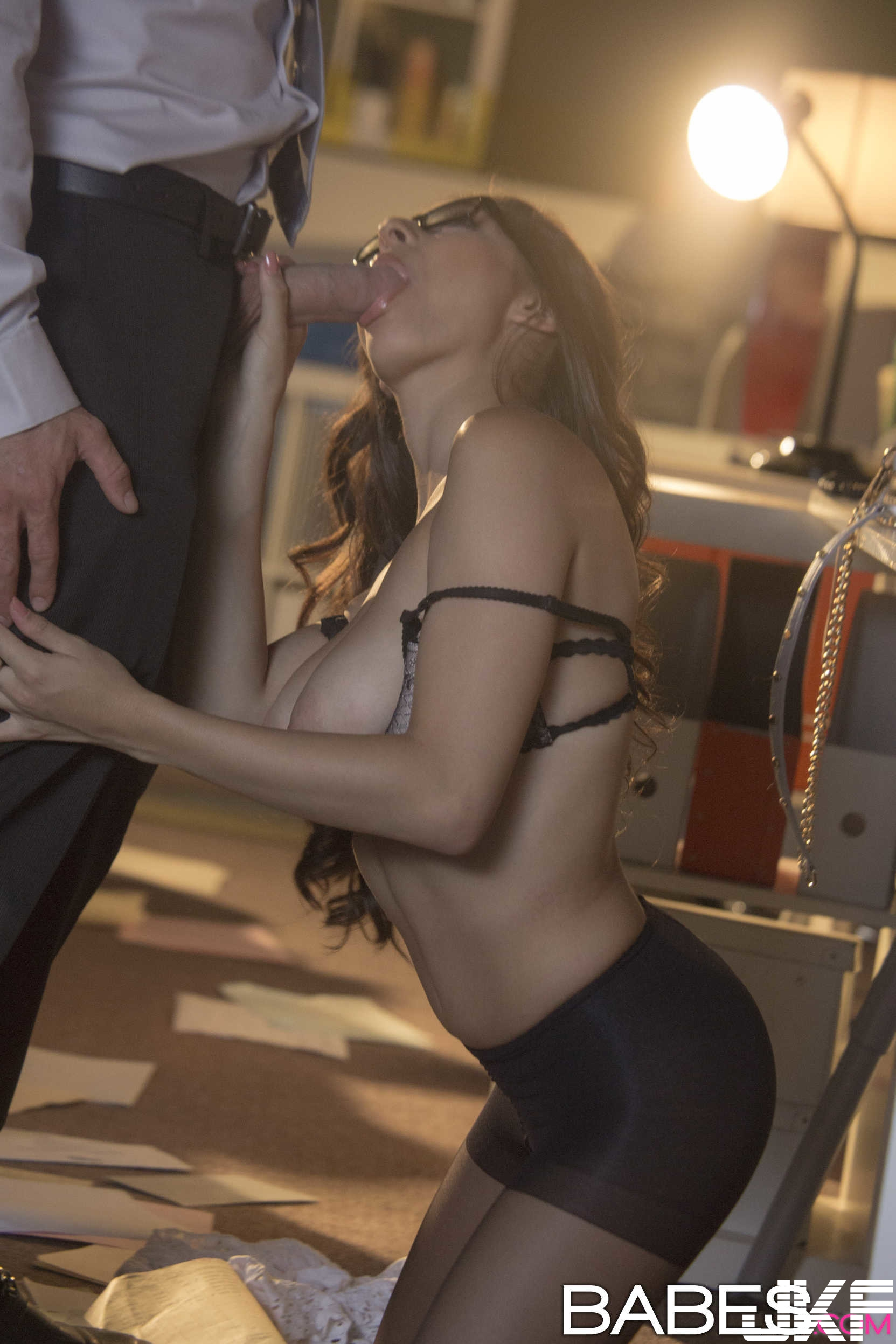 Shaved-Brunette-Nina-North-Wearing-Garter-Belt-in-Office-Giving-Blowjob-1.jpg