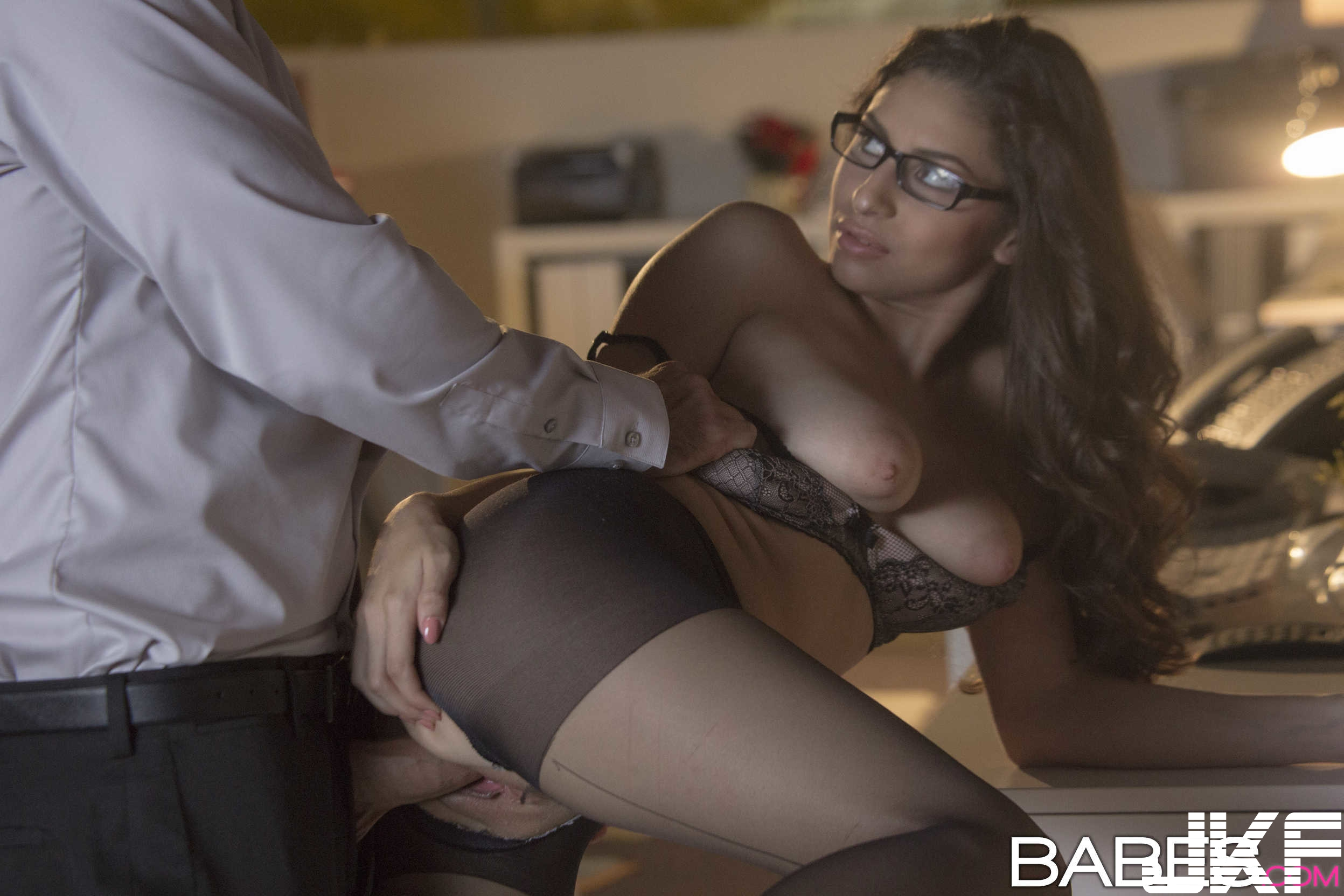 Shaved-Brunette-Nina-North-Wearing-Garter-Belt-in-Office-Giving-Blowjob-2.jpg