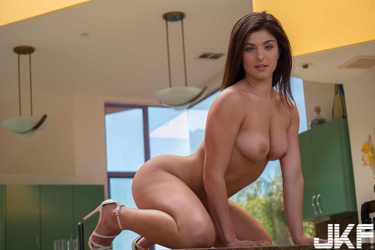 Shaved-Curvy-Brunette-Babe-Leah-Gotti-with-Blue-Eyes-in-Kitchen-Playing-With-Vib.jpg