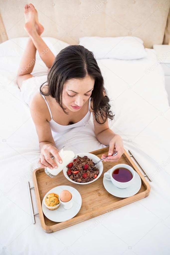 depositphotos_73422801-stock-photo-brunette-eating-her-breakfast-on.jpg