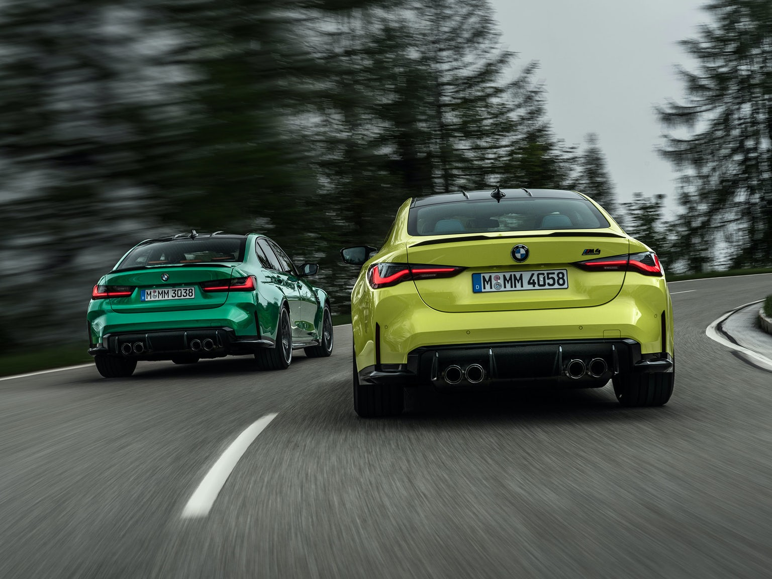bmw-m3-m4-competition-green-yellow-driving-rear-2.jpg